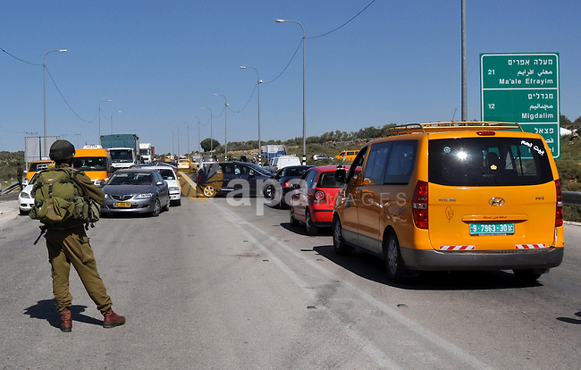 Israeli soldiers closed Tappuah checkpoint, after arrested two Palestinians young their has a pistol and explosion materials. southern Nablus city in the west bank,on April 21, 2012. Photo by Nedal Eshtaya