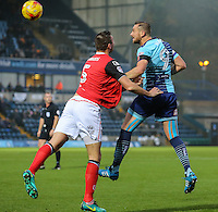 Paul Hayes of Wycombe Wanderers (right) wins the ball ahead of Ryan Edwards of Morecambe (left) during the Sky Bet League 2 match between Wycombe Wanderers and Morecambe at Adams Park, High Wycombe, England on 12 November 2016. Photo by David Horn.
