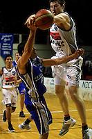 Callum Baynes blocks Luke Martin.<br /> NBL Basketball. Wellington Saints v Bay Hawks, TSB Bank Arena, Wellington. Saturday, 10 May 2008. Photo: Dave Lintott / lintottphoto.co.nz