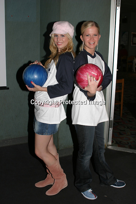 GL's Stephanie Gatschet and Crystal Hunt are bowled over by the event and the fans. Great time at the Bloss and Friends Bowling event Benefit American Heart Assn. This year this event raised over $5000. ( Photo by Sue Coflin)