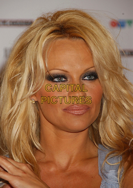 PAMELA ANDERSON.The 35th Annual JUNO Awards Press conference with host Pamela Anderson held at the Delta Halifax, Halifax, Nova Scotia, Canada..April 1st, 2006.Photo: Laura Farr/AdMedia/Capital Pictures.Ref: LF/ADM.headshot portrait .www.capitalpictures.com.sales@capitalpictures.com.© Capital Pictures.