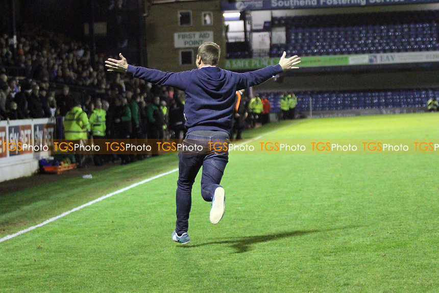 A Chester fan runs on the pitch at the final whistle - Southend United vs Chester - FA Challenge Cup 1st Round Football at Roots Hall, Southend on Sea, Essex - 08/11/14 - MANDATORY CREDIT: Mick Kearns/TGSPHOTO - Self billing applies where appropriate - contact@tgsphoto.co.uk - NO UNPAID USE