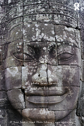 Carved stone face at Bayon Temple Angkor Wat, Siem Reap, Cambodia (Licence this image exclusively with Getty: http://www.gettyimages.com/detail/83676001 )