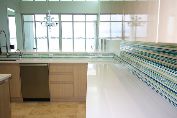 This custom kitchen backsplash features Random Stripes, a handmade  mosaic, shown in Peacock Topaz, Turquoise, Aquamarine, Peridot and Opal jewel glass.<br />