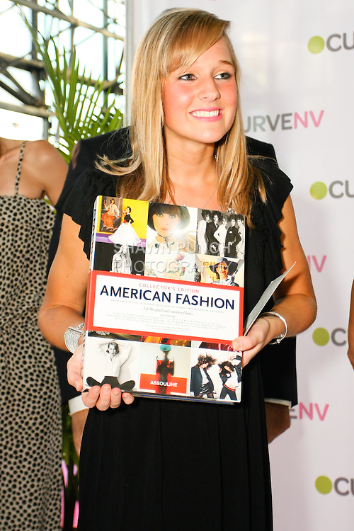 American Fashion book offered during the charity raffle at the CURVE and CFDA Party For A Cause event during the CURVENY Lingerie & Swim show, at the Jacob Javits Convention Center, August 2, 2010.