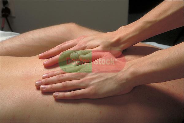 hands massaging patient's back