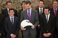 King Felipe VI of Spain receives a helmet from moto rider Marc Marquez during Royal Audience at Zarzuela Palace in Madrid, Spain. November 20, 2014. (ALTERPHOTOS/Victor Blanco) /NortePhoto.com<br /> /NortePhoto.com