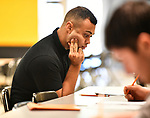 Justin Bristol of Edwardsville ponders a question on an assessment test at a Diversity Fair sponsored by the St. Louis County branch of the Ethical Society of Police. The fair was held at Hazelwood Central High School on Saturday August 11, 2018 with police agencies from ten different jurisdictions represented.   Photo by Tim Vizer