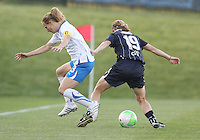 Rebecca Moros #19 of the Washington Freedom shields the ball from Kristine Lilly #13 of the Boston Breakers during a WPS match on May 8 2010, at the Maryland Soccerplex, in Boyds, Maryland. The game ended in a 0-0 tie.
