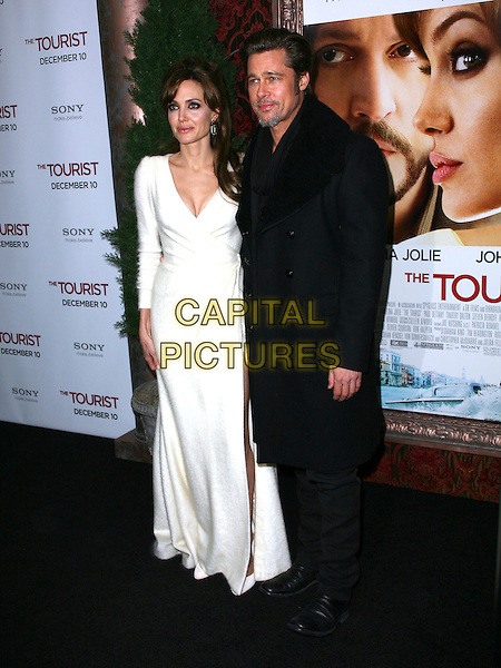 ANGELINA JOLIE & BRAD PITT .World premiere of 'The Tourist' at Ziegfeld Theatre in New York City, NY, USA, 6th December 2010..full length long maxi long sleeve   white wrap dress fluffy angora shoes black coat trousers couple .CAP/ADM/PZ.©Paul Zimmerman/AdMedia/Capital Pictures.