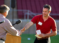 Stanford University athletics director Bob Bowlsby, shakes Todd Husak, hand during the Stanford Football Kick Off Dinner at Stanford Stadium on Thursday, August 25, 2011. ( © Norbert von der Groeben )