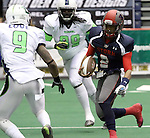SIOUX FALLS, SD - FEBRUARY 21:  Chris Dixon #2 from the Sioux Falls Storm looks for running room past Jamar Love #9 and Jamar Love #99 from the Nebraska Danger in the first quarter of their game Friday night at the Sioux Falls Arena. (Photo by Dave Eggen/Inertia)