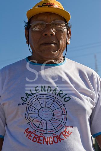 Pará State, Brazil. The town of Tucumã. Pedro Kayapó from Aldeia Kikretum wearing a Mebengokre (Kayapo) calendar t-shirt.