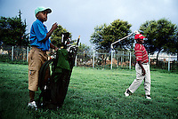 SOWETO, SOUTH AFRICA - MARCH 28: An unidentified man plays golf with a young boy as caddie on March 28 at the Soweto Country Club in Soweto outside Johannesburg, SA. A growing number of people belong to the new black elite in the country. Well educated and connected, they have risen from the poverty in the townships to a very different lifestyle, since the fall of Apartheid and the start of democracy in the country in 1994.  (Per-Anders Pettersson)