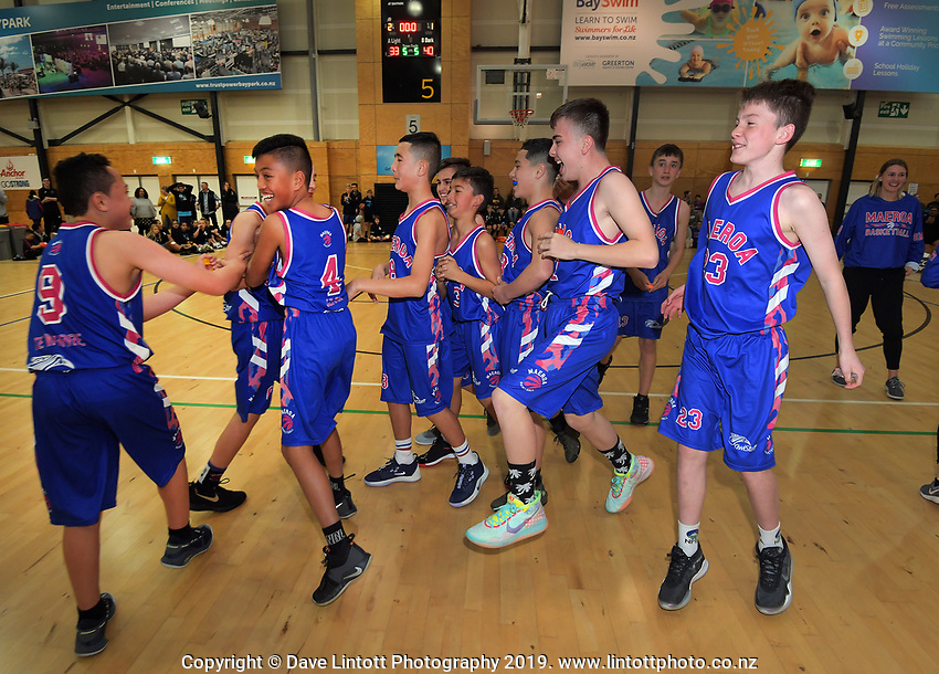 Maeroa celebrate winning the boys' basketball final between Maeroa Intermediate and Heretaunga Intermediate on Day six of the 2019 AIMS games at Baypark in Mount Maunganui, New Zealand on Friday, 13 September 2019. Photo: Dave Lintott / lintottphoto.co.nz