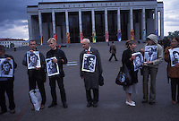 MINSK, BELARUS - MAY 7: People participate in The Chain of Concerned People holds a peaceful protest on May 7, 2004 in Minsk, Belarus. The posters are of people who were arrested and presumed to have been killed by the Lukashenko regime for speaking out against it. For years, Belarus was frozen in its communist past. Now the radical change that has swept the former Soviet Union -- from Georgia's 2003 popular uprising to Ukraine's orange revolution last winter to the recent meltdown in Kyrgyzstan -- is catching up with President Alexander Lukashenko, a dictator whose regime has been described as Stalinism minus the Gulag. The images here capture a country and a people inexorably moving toward revolution: Student activists organizing illegally, democratic reformers meeting in rusting warehouses, protesters holding pictures of 'enemies of the state' murdered by the security services. Just beneath the apparent ordinariness and staidness of this post-Soviet republic, which is barely distinguishable from its former Soviet self, is a deep and powerful anger and a yearning for a new politics and a new possibility. That is the crux of Belarus today -- anger and yearning held together by the glimmer of a hope that tomorrow the regime may tumble. (Photo by Landon Nordeman)