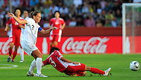Christie Rampone (l) of Team USA and Ho Un Byol of Team North Korea during the FIFA Women's World Cup at the FIFA Stadium in Dresden, Germany on June 28th, 2011.