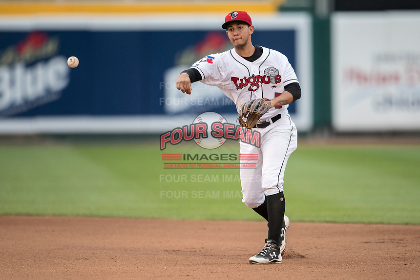Lansing Lugnuts second baseman Yeltsin Gudino (5) makes a throw to first base during the Midwest League baseball game against the Bowling Green Hot Rods on June 29, 2017 at Cooley Law School Stadium in Lansing, Michigan. Bowling Green defeated Lansing 11-9 in 10 innings. (Andrew Woolley/Four Seam Images)