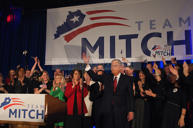 United States Minority Leader Mitch McConnell and his wife Elaine Chao wave to the crowd at his victory celebration after defeating challenger Alison Lundergan Grimes in Louisville, Ky.,on Tuesday, November 4, 2014. Photo by Michael Reaves | Staff