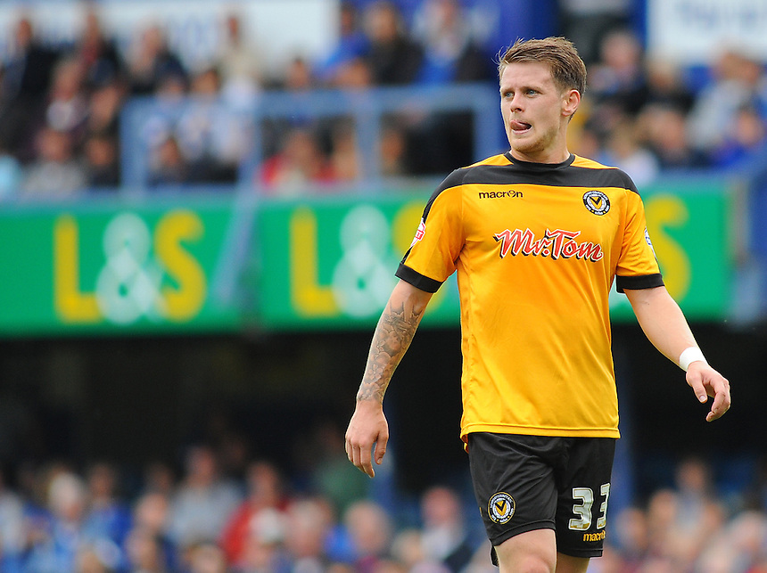Newport County's Mark Byrne in action during todays match  <br /> <br /> Photographer Kevin Barnes/CameraSport<br /> <br /> Football - The Football League Sky Bet League Two - Portsmouth v Newport County AFC - Saturday 30th August 2014 - Fratton Park - Portsmouth<br /> <br /> &copy; CameraSport - 43 Linden Ave. Countesthorpe. Leicester. England. LE8 5PG - Tel: +44 (0) 116 277 4147 - admin@camerasport.com - www.camerasport.com