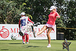 Natalie Gulbis kicks a football at the 14th hole during the World Celebrity Pro-Am 2016 Mission Hills China Golf Tournament on 22 October 2016, in Haikou, China. Photo by Weixiang Lim / Power Sport Images