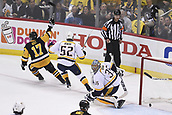 8th June 2017, Pittsburgh, PA, USA; Pittsburgh Penguins right wing Bryan Rust (17) celebrates his goal past Nashville Predators goalie Pekka Rinne (35) during the first period in Game Five of the 2017 NHL Stanley Cup Final between the Nashville Predators and the Pittsburgh Penguins on June 8, 2017, at PPG Paints Arena
