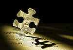 Jigsaw puzzle reflecting Indian currency symbol