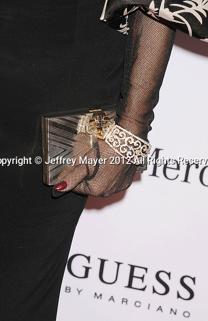 BEVERLY HILLS, CA - OCTOBER 20: Joan Collins (handbag, bracelet detail) at the 26th Anniversary Carousel Of Hope Ball presented by Mercedes-Benz at The Beverly Hilton Hotel on October 20, 2012 in Beverly Hills, California.
