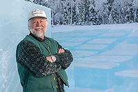 Dick Brickly stands by blocks of ice that will be used during the World Ice Art Championships in Fairbanks, Alaska.
