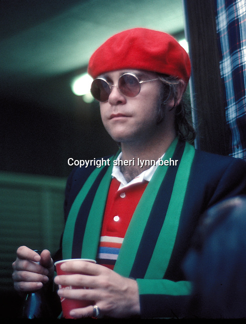 Elton John waits backstage at the Dr. Pepper Music Festival in Central Park, NY in 1977