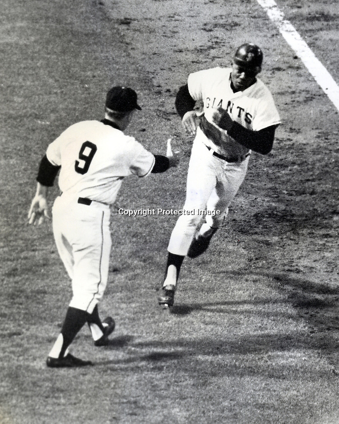Giant slugger Willie Mays gets congrats from the 3rd base coach as he hits home run. (photo 1966 Ron Riesterer)