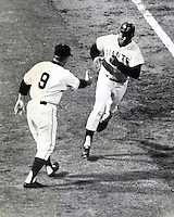 Giant slugger Willie Mays gets congrats from the 3rd base coach after home run. (photo 1966 Ron Riesterer)