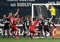 Troy Perkins #23 of D.C. United collects a header from Ty Hardin #20 of Toronto FC during an MLS match that was the final appearance of D.C. United's Jaime Moreno at RFK Stadium, in Washington D.C. on October 23, 2010. Toronto won 3-2.