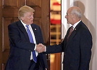 United States President-elect Donald Trump (L) shakes hands with retired US Marine Corp General John Kelly at the clubhouse of Trump International Golf Club, in Bedminster Township, New Jersey, USA, 20 November 2016.<br /> Credit: Peter Foley / Pool via CNP /MediaPunch