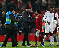 5th November 2019; Anfield, Liverpool, Merseyside, England; UEFA Champions League Football, Liverpool versus Genk; Liverpool manager Jurgen Klopp shakes hands with Mohammed Salah of Liverpool  after the match ends with a 2-1 win for Liverpool - Editorial Use
