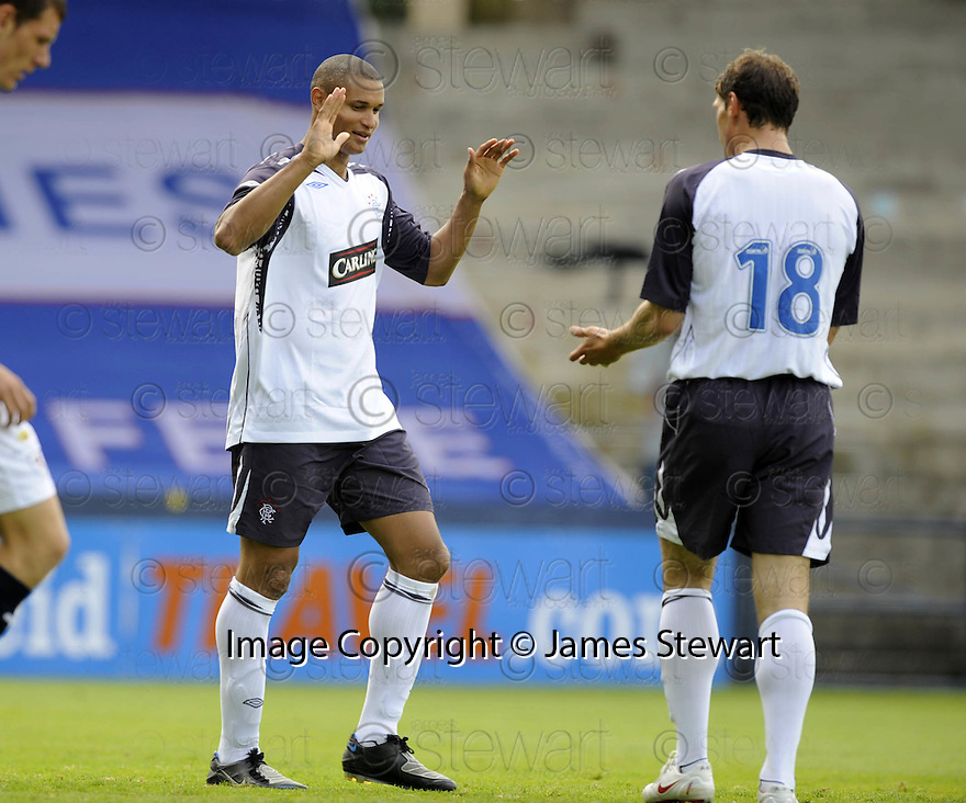 26/07/2008  Collect Pic: James Stewart.File Name : sct_jspa16_raith_v_rangers.DANIEL COUSIN CELEBRATES AFTER HE SCORES RANGERS SECOND.James Stewart Photo Agency 19 Carronlea Drive, Falkirk. FK2 8DN      Vat Reg No. 607 6932 25.Studio      : +44 (0)1324 611191 .Mobile      : +44 (0)7721 416997.E-mail  :  jim@jspa.co.uk.If you require further information then contact Jim Stewart on any of the numbers above........