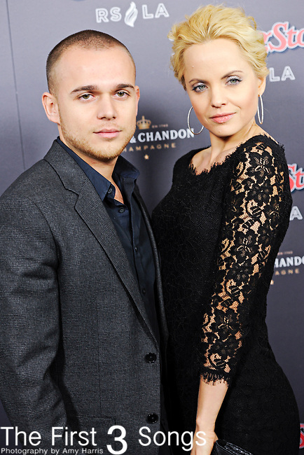 Mena Suvari and husband Simone Sestito attend the 2010 American Music Awards VIP After Party hosted by Rolling Stone Magazine at the Rolling Stone Restaurant & Lounge in Los Angeles, California.