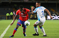 BOGOTA - COLOMBIA, 12-06-2019: Andrey Estupiñan del Pasto disputa el balón con German Gutierrez de Junior durante partido de vuelta por la final de la Liga Águila I 2019 entre Deportivo Pasto y Atlético Junior jugado en el estadio Nemesio Camacho El Campín de la ciudad de Bogotá. / Andrey Estupiñan of Pasto vies for the ball with German Gutierrez of Junior during second leg match between Deportivo Pasto and Atletico Junior for the final of the Aguila League I 2019 played at Nemesio Camacho El Campin stadium in Bogota city. Photo: VizzorImage / Felipe Caicedo / Staff