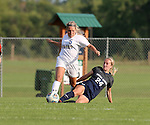 BROOKINGS, SD - August 19:  Lauren Kressock #5 from South Dakota State tries to control the ball as Jayne Robison-Merrill #24 from Utah State slides to knock the ball away during the first half of their match at Fischback Soccer Field in Brookings. (Photo by Dave Eggen/Inertia)