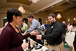PROSPECT, CT-28 October 2014-102814EC01--   Andrew Fredericksen of Shebeen Brewing gives Chelsea Schmidt a sample of the company's fall variety. The Exchange Club of Wolcott put on Tuesday night's event at Aria in Prospect. The annual wine tasting and silent auction benefited the Denis Y. Desaulniers charity and the club, which advocates against child abuse. Erin Covey Republican-American
