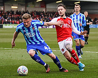 Blackpool's Taylor Moore holds off a challenge from Fleetwood Town's Barrie McKay<br /> <br /> Photographer Lee Parker/CameraSport<br /> <br /> The EFL Sky Bet League One - Fleetwood Town v Blackpool - Saturday 7th March 2020 - Highbury Stadium - Fleetwood<br /> <br /> World Copyright © 2020 CameraSport. All rights reserved. 43 Linden Ave. Countesthorpe. Leicester. England. LE8 5PG - Tel: +44 (0) 116 277 4147 - admin@camerasport.com - www.camerasport.com