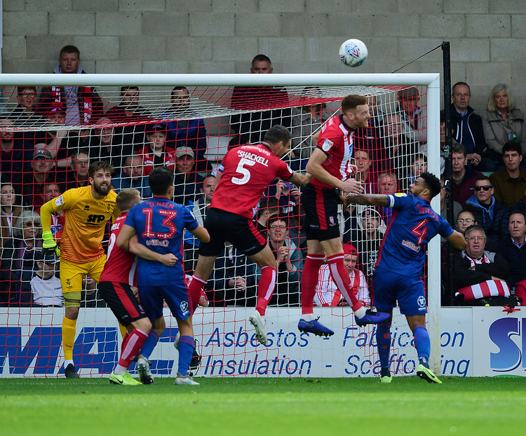 Lincoln City's Cian Bolger heads clear under pressure from Sunderland's Jordan Willis<br /> <br /> Photographer Andrew Vaughan/CameraSport<br /> <br /> The EFL Sky Bet League One - Lincoln City v Sunderland - Saturday 5th October 2019 - Sincil Bank - Lincoln<br /> <br /> World Copyright © 2019 CameraSport. All rights reserved. 43 Linden Ave. Countesthorpe. Leicester. England. LE8 5PG - Tel: +44 (0) 116 277 4147 - admin@camerasport.com - www.camerasport.com