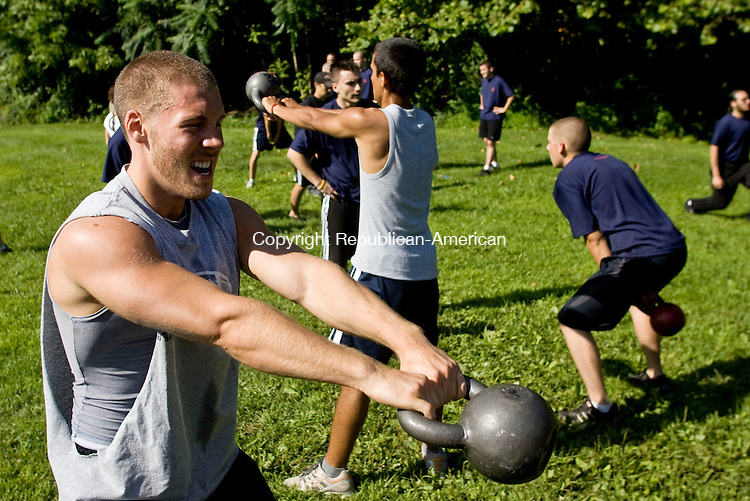 WATERTOWN, CT - 08 AUGUST 2009 -080809JT04-<br /> Marine recruits Connor Berger of Waterbury exercises with a kettlebell as he and dozens of other recruits participate in a training exercise provided by CrossFit Watertown on Saturday. Almost 40 area recruits participated in the free intensive exercise regimen.<br /> Josalee Thrift Republican-American