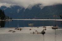 Kayak school against moody sky. Deep Cove, North Vancouver, British Columbia, Canada.
