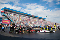 Oct 12, 2019; Concord, NC, USA; NHRA top fuel driver Billy Torrence is pushed into position by crew members during qualifying for the Carolina Nationals at zMax Dragway. Mandatory Credit: Mark J. Rebilas-USA TODAY Sports