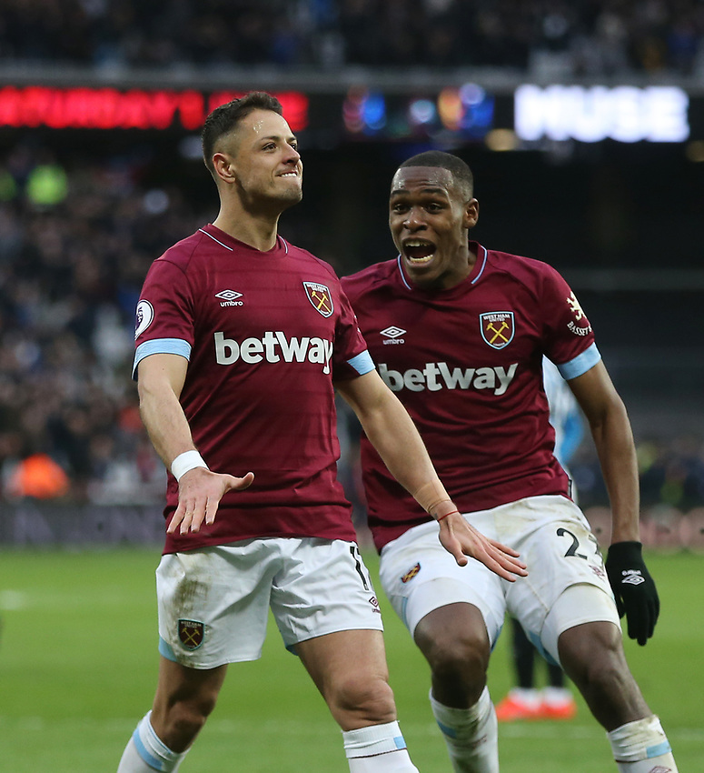 West Ham United's Javier Hernandez celebrates scoring his side's fourth goal with Issa Diop<br /> <br /> Photographer Rob Newell/CameraSport<br /> <br /> The Premier League - West Ham United v Huddersfield Town - Saturday 16th March 2019 - London Stadium - London<br /> <br /> World Copyright © 2019 CameraSport. All rights reserved. 43 Linden Ave. Countesthorpe. Leicester. England. LE8 5PG - Tel: +44 (0) 116 277 4147 - admin@camerasport.com - www.camerasport.com