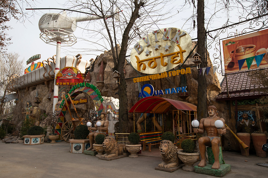 Uzbekistan - Tashkent - An amusement park in the neighborhood of Sputnik. Sputnik was built in 1966 after the earthquake to relocate part of the 300,000 people who had lost their house. The wooden houses were meant to cover the emergency but the area is still inhabited.
