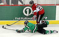 North Dakota's Danny Kristo tries to keep control of the puck as UNO's Brent Gwidt closes in. No. 4 UNO beat No. 7 North Dakota 1-0 Saturday night at Qwest Center Omaha. (Photo by Michelle Bishop)