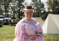 NWA Democrat-Gazette/CHARLIE KAIJO Joli Lewis of Joplin, Mo. looks on, Friday, October 4, 2019 at a field north of Pea Ridge along the Missouri border in Pea Ridge. Lewis is a seamstress who created her entire outfit by hand including her corset, cage and two starch petty coats. <br /> <br /> Members of the Trans Mississippi Brigade set up camp for visitors to see life as it was in the 1860s in a battle camp. The camp will be open from 9 a.m. to 9 p.m. Friday through Sunday. There will be two battle reenactments — one at 1 p.m. Saturday and the other at 1 p.m. Sunday. The battle on Saturday will reenact the Battle of Elkhorn that was won by the Confederates. The battle on Sunday will be Welfley's Knoll and the Union will win.