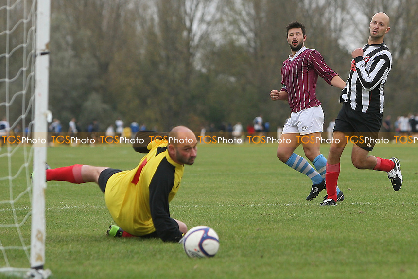 Bristow City (purple) vs Bow Badgers (black/white) - Hackney & Leyton Sunday League Football at South Marsh, Hackney Marshes, London - 05/11/11 - MANDATORY CREDIT: Gavin Ellis/TGSPHOTO - Self billing applies where appropriate - 0845 094 6026 - contact@tgsphoto.co.uk - NO UNPAID USE.